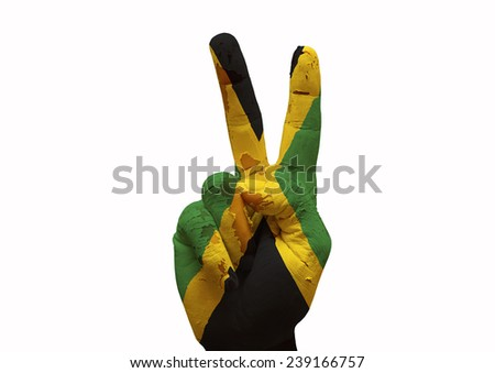 Hand making the V sign country flag painted jamaica - stock photo
