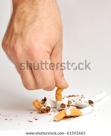 hand man crushes last cigarette. stop smoking - stock photo