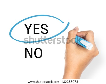 Hand mark on Yes with blue pen isolated on white background - stock photo