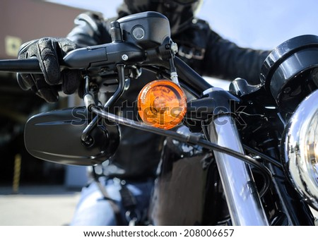 hand of a biker on a throttle control - stock photo