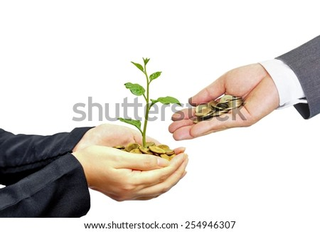 hand of a businessman giving coins to hands holding a tree growing on golden coins - business with csr practice - stock photo