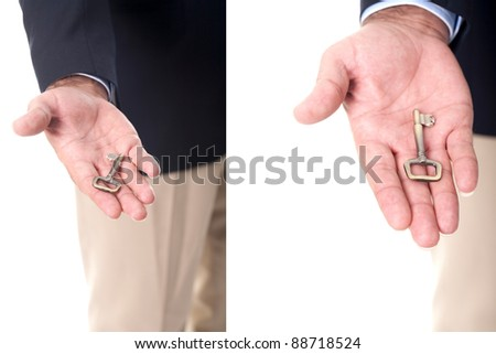 hand of a businessman holding a house key - stock photo