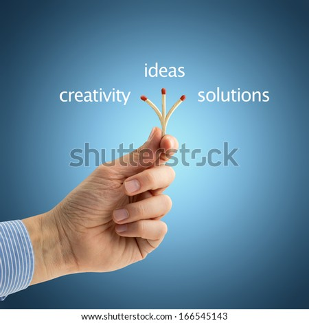 hand of a businessman holding a triple matchstick  - stock photo