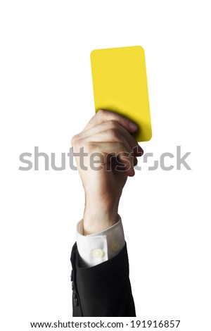 hand of a businessman holding a yellow card in the air - stock photo