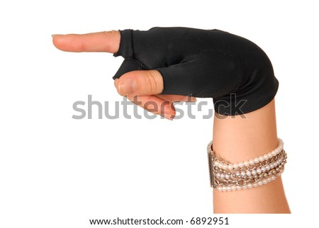 hand of a girl in black glove showing the direction - stock photo