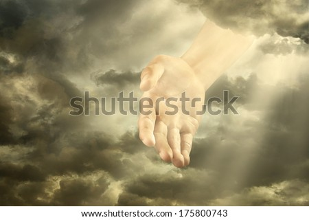 Hand of a god down from the sky - stock photo
