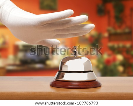 Hand of a man using a hotel bell - stock photo