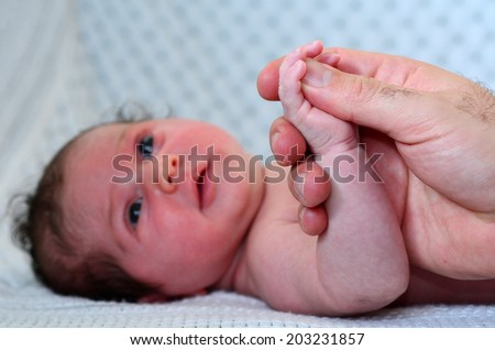 Hand of a young father touch his newborn baby hand.copyspace - stock photo