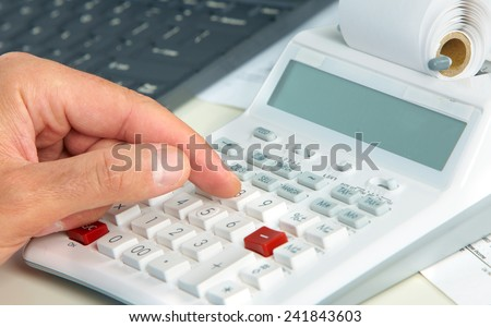 Hand of accountant man with calculator. Accounting - stock photo