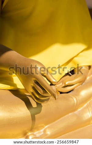 Hand of Buddha statue - stock photo