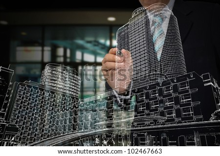 Hand of Business Man draw cityscape - stock photo