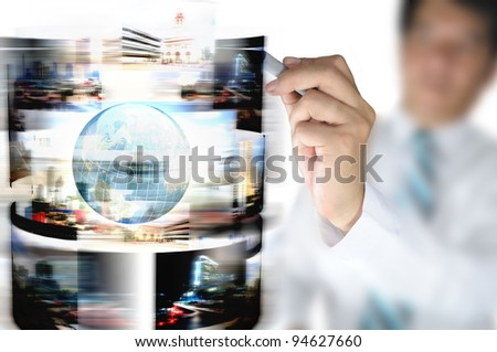 Hand of business man draw streaming images with earth globe - stock photo