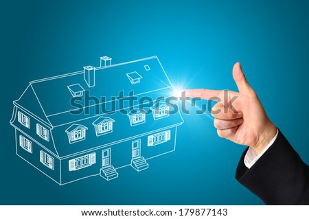 Hand of business man point to house or home - stock photo