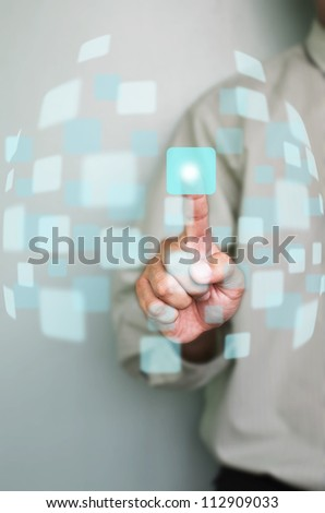 hand of business man pushing on a touch screen interface - stock photo