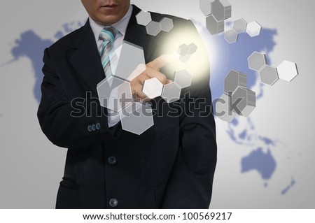 Hand of Business Man touch Hexagon interface. - stock photo