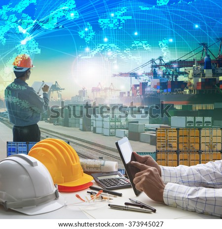 hand of business man working on  table in container dock use for logistic industry and import export , freight cargo shipping industrial - stock photo
