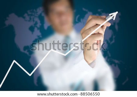 Hand of business man write a 3d business graph on tablet pc touch screen - stock photo