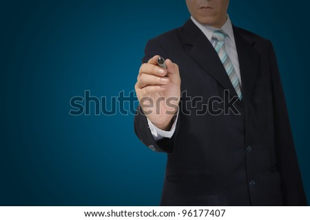 Hand of business man writing on tablet pc touch screen - stock photo