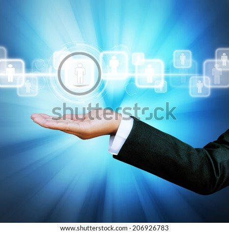 hand of business women pushing a button on a touch screen interface digital on background blue  - stock photo