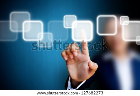hand of business women pushing a button on a touch screen interface on button - stock photo