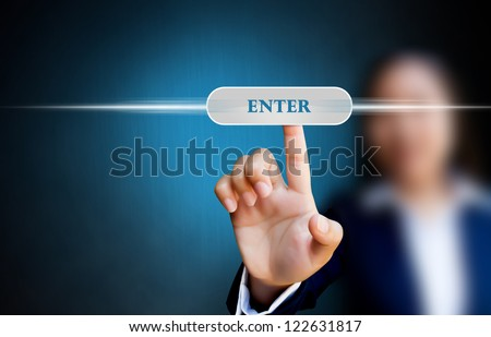 hand of business women pushing a button on a touch screen interface on enter button - stock photo