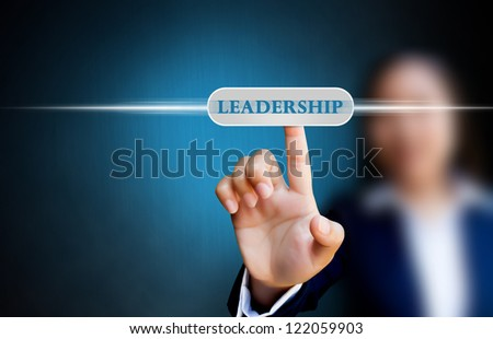 hand of business women pushing a button on a touch screen interface on  leadership button - stock photo