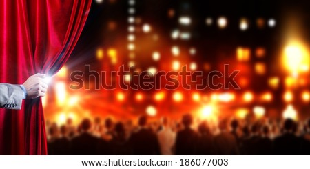 Hand of businessman opening red velvet curtain - stock photo