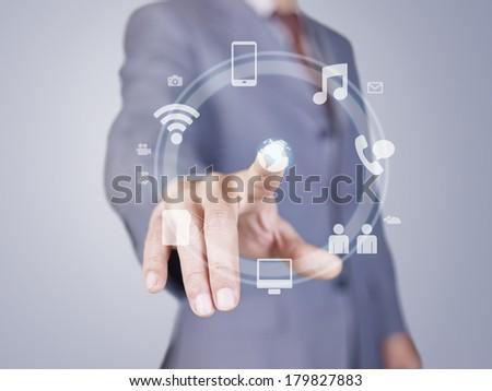 hand of businessman pressing virtual button. - stock photo