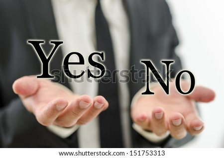 Hand of businessman weighing word Yes and No. Concept of decision making. - stock photo