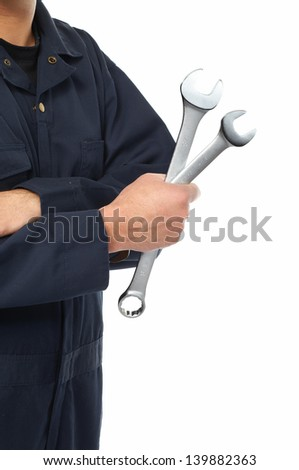 Hand of car mechanic with a wrench. Isolated over white background. - stock photo