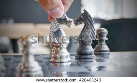 Hand of chess player moving the checkmate - stock photo