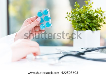 Hand of female medicine doctor holding tablet blister closeup.  - stock photo