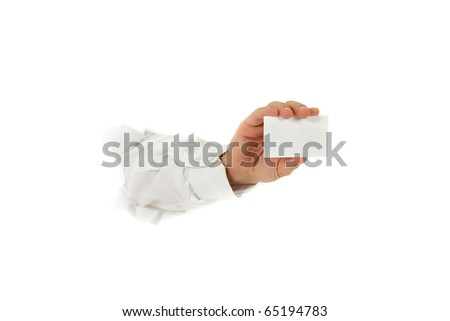 Hand of man breaking through a paper wall showing a blank, white business card. Copy space. Studio shot. White background. - stock photo