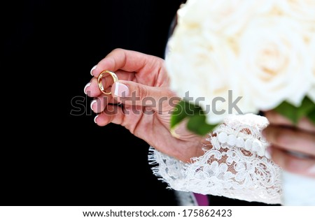 Hand of senior woman holding engagement ring - stock photo