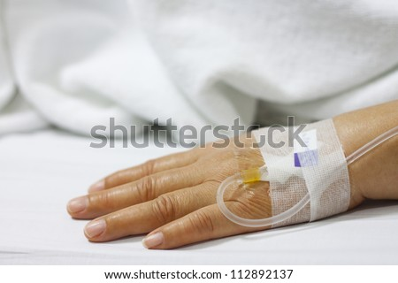 Hand of The Patient in the Hospital - stock photo