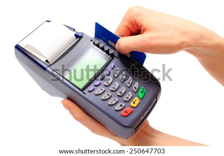 Hand of woman using payment terminal, paying with credit card, credit card reader, finance concept - stock photo