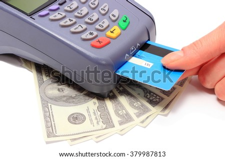 Hand of woman using payment terminal, paying with credit card, credit card reader with cash, finance concept - stock photo