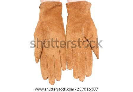 Hand of woman with suede gloves, beautiful brown leather gloves. Isolated on white background - stock photo