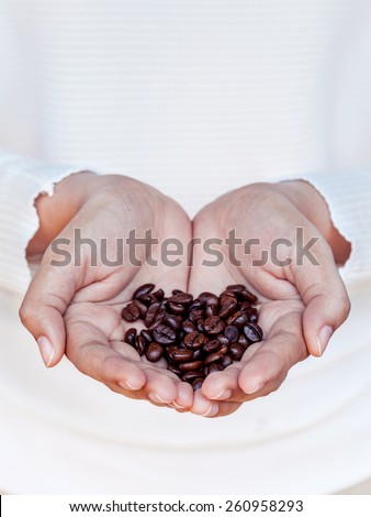Hand of women holding coffee beans . - Concept for giving refreshing. - stock photo