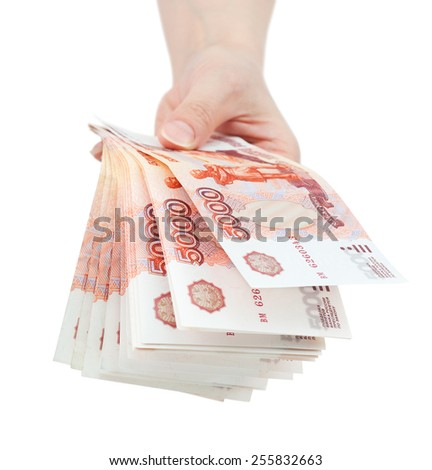 hand offer batch of many 5000 rouble bills (the biggest Russian bond) - stock photo