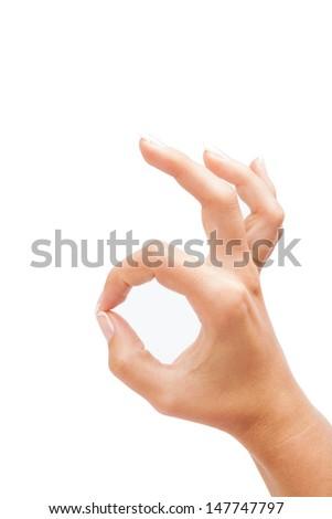 Hand OK sign on white background - stock photo