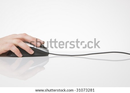 hand on computer mouse - stock photo