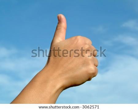 Hand on sky in gesture positive OK - stock photo