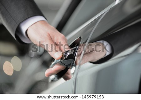 Hand on the car handle. Businessman holding his hand on the casr handle - stock photo