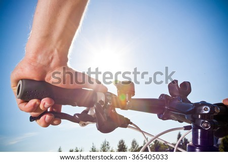 hand on the handlebars - stock photo