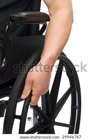 Hand on wheel chair with white background - stock photo