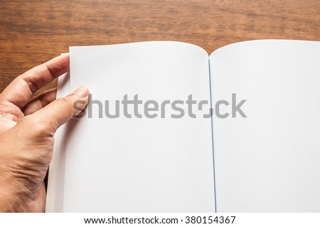hand open blank book on  table  - stock photo