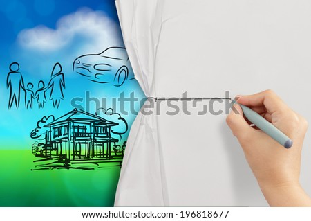 hand open crumpled paper to show planning family future blue and green nature background as concept - stock photo