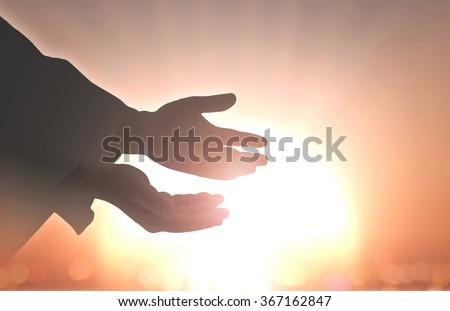 Hand Open Palm Up Redeem Eucharist Bless God Help Christian God Repent Catholic Church Creation Grace Lent Week Great Mind Fast National Prayer Dua Quran Gospel Peace Ocean Source Soulful Therapy Sun - stock photo