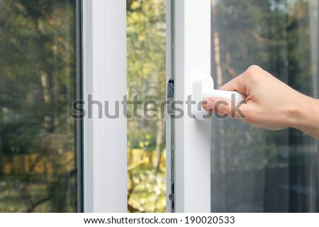 hand open plastic window - stock photo
